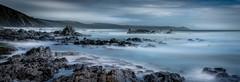 Rocky Vista (Mick Blakey) Tags: shoreline slowexposure rugged cornish rocky sea tranquil azure beach panoramic mist silhoette coastal relaxing blue misty seascape coast cornwall whitsandbay rocks