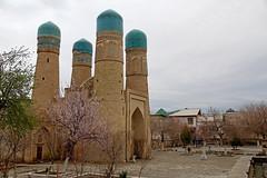 The Char Minar (Four Minarets) of Bukhara, Uzbekistan with some spring blossom after a rainfall