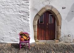Colourful Baskets (Jocelyn777) Tags: white chair baskets doors whitehouses whitevillages villages street road stones arch monsaraz alentejo portugal travel