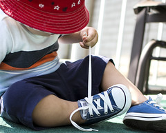 Experimenting (Danny VB) Tags: converse shoes footwear baby babies bébé enfant kid children outside playing experimenting discovering canon summer montreal quebec canada hat red redhat chapeaurouge joue 7d sigma 30mm14 allstar