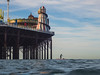 Long Boarder and Brighton Pier (lomokev) Tags: england unitedkingdom gb olympusomdem5 olympus omd em5 olympusomd brighton pier brightonpier palacepier helterskelter carousel water sea longboarder longboard