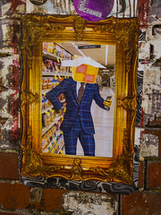Mr Battenberg (Steve Taylor (Photography)) Tags: battenberg cake supermarket aisle cakemixes frame suit tie head selfie square shelf yourcorner art graffiti pasteup wheatup wheatpaste picture streetart sticker weird crazy mad odd strange brick paper man uk gb england greatbritain unitedkingdom london mobile phone