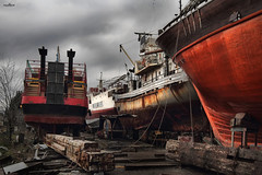 ship stories (dim.pagiantzas   photography) Tags: ships shipyard ship metal rust textures atmospheric dark cinematic rope colors wood wooden old sky clouds cloudy outdoor