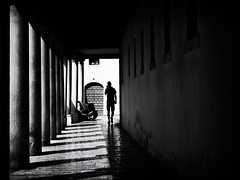 Silhouette (Sandy...J) Tags: olympus monochrom atmosphere alone architecture man walking walk light street streetphotography shadow blackwhite bw urban darkness photography passage noir silhouette italy