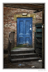 The Blue Door (Seven_Wishes) Tags: newcastleupontyne outdoor photoborder canoneos5dmarkiv canonef24105mmf4lisii nm urban grime gritty textures steps stairs door bluedoor railings banister decay weathered redbrick building entrance lowkey