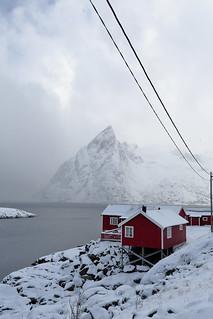 Tourist rorbuer-traditional fishing cottages-Olstinden mount across the Reinefjorden. Hamnoy-Reine-Moskenesoya-Lofoten-Norway. 0374