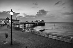 Cromer Pier - an evening in September (3pebbles) Tags: blackwhite monochrome cromer norfolk beach coast pier seaside coastal lamp promenade esplanade victorian sky evening dusk lamplight theatre