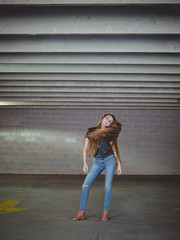 Break free from these walls (Vincent F Tsai) Tags: fashion art portrait contemporary model girl dynamic movement hair parking deck garage layer concrete space scale young youth panasonic leicadgnocticron425mmf12 lumixgx8