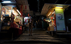"""steps..."" (hugo poon - one day in my life) Tags: xt1 14mm hongkong central pottingerstreet stoneslabstreet steps wellingtonstreet citynight colours stall solitude phone vanishing lights streetlife"