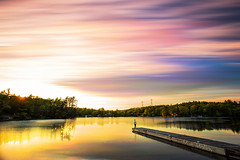 Lake of Gold (Matt Molloy) Tags: mattmolloy timelapse photography timestack photostack movement motion sunset colourful sky clouds trails lines sun light trees gold water reflection me myself dock jonesfalls ontario canada landscape lovelife