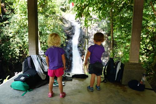 Madeleine and Sawyer watch people slide down the Aling Aling waterfall