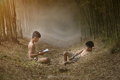 The classroom in bamboo forest (superpong) Tags: child children bamboo classroom red gold light smoke asia read book thailand people life