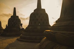 Enjoying the sunrise (Syahrel Azha Hashim) Tags: sonyimages expression carvings tourist indonesia structure wonders simple morning 2017 details borobudur dramaticsky sony prime sonya7 heritage 35mm hijab a7ii temple placeofworship dof shadow ilce7m2 touristattraction building getaway shades sunrise oneperson handheld holiday colorimage vacation destination handbag texture bellshaped naturallight moment jogjakarta clouds beautiful travel syahrel colorful shallow colors architecture unesco people light detail