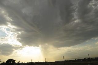 Virga descending from storm clouds