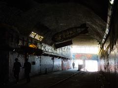 The Vaults (Steve Taylor (Photography)) Tags: vaults leakestreet glow shiny graffiti sign streetart contrast creepy eerie people men man uk gb england greatbritain unitedkingdom london glare perspective texture tunnel passage