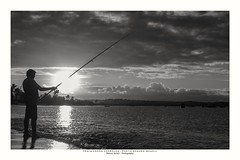 The fisherman. (Marcos Jerlich) Tags: holiday landscape september nature silhouette sunlight goldenhour flickr 7dwf beach happy sport fisherman againstlight seaside light clouds monochromemonday hmm bw blackandwhite bnw monochrome blancoynegro mono brasil américadosul canon canont5i canon700d efs1855mm bahia portoseguro marcosjerlich