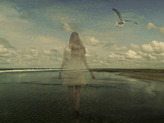 Between dreams and reality (Abby.2) Tags: sea seagull clouds white dress woman beach reflection wind blue sky netherlands sand dark ghost