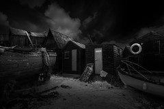 Shanties (jellyfire) Tags: agriculture black blackandwhite canon5dmkii derelict distagont3518 eastanglia ir landscape landscapephotography mono southwold southwoldharbour storm suffolk ze zeissdistagont18mmf35ze abandoned boat boatr canon clouds field fishermanshut fishing industry infrared monochrome sky zeiss