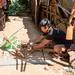 Kayan man producing a crossbow