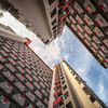 Engineered Majulahs (Scintt) Tags: singapore national day flags pattern selegie house short street tessellation building architecture structure urban exploration public housing flats apartments homes estate lines city cityscape jon chiang photography scintillation scintt ndp ndp2017 bugis order 17mm tilt shift tse sony a7r pano stitched shapes abstract modern apartment hdb facade light glow dramatic contrast sun shadows patterns laundry walls explore texture evening contrasty directional travel sky clouds lookup vanishingpoint perspective