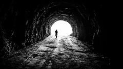 Exploring - Vidraru, Romania - Black and white street photography (Giuseppe Milo (www.pixael.com)) Tags: streetphotography man romania silhouette cave vidraru tunnel street bandw faceless contrast blackandwhite walking județulargeș ro onsale