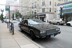 Darth Monte (Flint Foto Factory) Tags: chicago illinois urban city summer august 2017 north edgewater brynmawr historic district sunday morning edgewaterbeach apartments 7eleven francescas italian restaurant 1981 1982 1983 1984 1985 chevrolet chevy monte carlo darth vader custom grille wheels sooc straightoutof camera generalmotors gm gbody platform intermediate midsize personal luxury car front threequarter view black color street parking sidewalk
