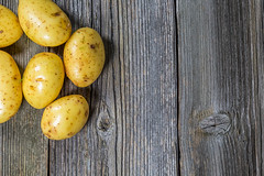 Bunch of potatoes on wooden background (AudioClassic) Tags: healthy organic harvest farm fresh food potato background vegetable agriculture wooden ingredient rustic nutrition natural produce raw brown nature dirty wood vegetarian table group diet rural market root heap many uncooked view health top text plant meal farmer autumn vegan vitamin seasonal kitchen objects color closeup delicious healthcare dill parsley