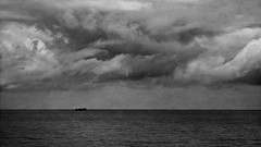 Calm seas and turbulent clouds (noompty) Tags: newcastle nsw australia ocean ship clouds storm bw on1pics pentax k5 smcpda50135mmf28edifsdm merewether