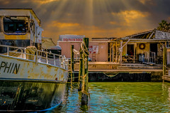 Dolphin Docks (Jims_photos) Tags: water texas unitedstates outdoor outside ocean portisabeltexas adobelightroom adobephotoshop shadows sunnyday daytime docks fishingboat gulfofmexico jimallen jimsphotos jimsphotoswimberleytexas lightroom texascoast cloudy clouds coastalscene boats nopeople