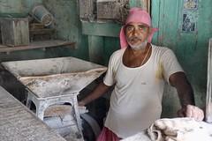 Flour maker, Mumbai (Yekkes) Tags: asia india mumbai bombay man worker green pink masculine handsome beard