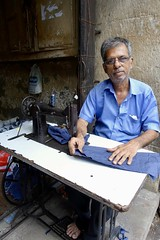 Tailor working in the street, Mumbai (Yekkes) Tags: asia india mumbai bombay maharshtra taylor work tradition street indian machinery sewingmachine dignified sewing