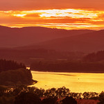 Colorful idyllic sunset landscape at lake Lipno, Czech mountains Sumava,  Bohemian forest or Böhmerwald, Bavarian Forest or Böhmische Wald thumbnail