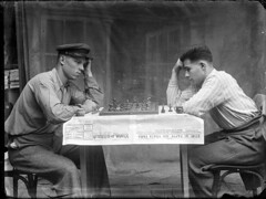 ca_20170813_001 (Costică Acsinte Archive) Tags: 20170813 glassplate ialomita românia rou costicăacsintearchive costicăacsinte camilitary photo photograph blackandwhite men chess playing leaning table chessboard board game 1940s