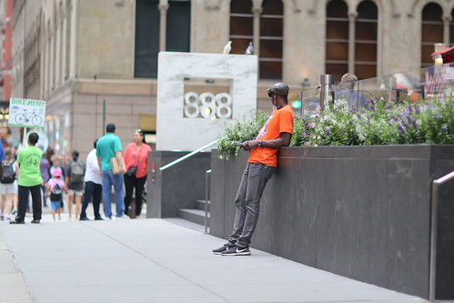 A guy on 7th Avenue near 56th Street looking for tourists to hand brochures to.