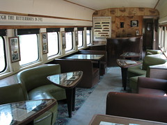 Serving Days Past (alwaysakid) Tags: railroad diner passenger car railway seats tables milw milwaukeeroad train interior diningarea couch booth room carpet