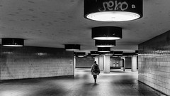 Lonely (Leipzig_trifft_Wien) Tags: black white monochrome building underground ubahn city tiles light shadow alone lonely street person people berlin germany europe urban subway walking bw contrast geometry circle minimalism