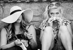 Tourist break (david_chapelle) Tags: bag blonde blowing eating florence handkerchief hat italy people street tissue two wimen