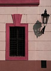 untitled (prague, czech republic) (bloodybee) Tags: prague praha bohemia czechrepublic travel trip street lamp window house facade wall building shadow pink