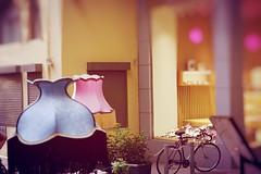 Day 262 : Is for ... The Magic Street Moments (Storyteller.....) Tags: ngc nikon nikon365 365 deep365 athens street moments colors blue pink yellow bicycle vitrine lamp light magic strange