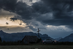Before the storm (Tiomax80) Tags: roadtrip familyholidays bluehour ancelle hautesalpes storm alpes alps mountains landscape mountainscape france skoda superb skodasuperb skodafrance sedan car cappucino familycar sky dramatic dramaticsky dark grey darksky stormy stormysky cross cloudy clouds nikon d610 bilora tripod nikkor tiomax chapel green grass lawn blue heurebleue heure bleue hour recordtrunk sunset peaks pass lights headlights biloratripod max tiomax83 tiomax80 85mm dramaticscene summer mountain country altitude high sainthilaire paca