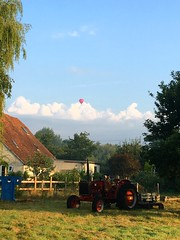 Up, up, and away (Jackie Grebby) Tags: old stocks pillory tractor hotairballoon balloon clouds sky