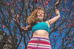 Spring Coming (Lara Carro) Tags: girl woman sol sun cielo blue pink flowers tree arbol garden jardin crochet