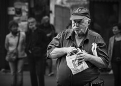 The Streets of Bucharest II (DragosDogioiu) Tags: romania bucharest nikon d3300 people street old withered wrinkles man glutton food
