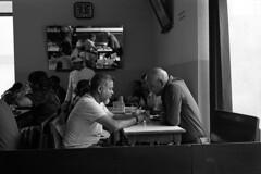 Conversations over Coffee (S a b i r) Tags: sabir bangalore indiacoffeehouse churchstreet streetphotography street streetlife coffee coffeehouse leica m3 rangefinder voigtlander 40f14 arista aristapremium ei100 kodak hc110 dilh epsonv700