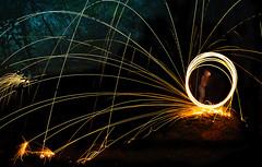 Forever Spinning (djnightsphotography) Tags: djnightsphotography suzannebainton photographer steelwoolphotography steelwool fire figure forest forestfloor dark dance wwwdjnightsphotographycom lightpainting lightstream undergroundmovement longexposure women lines trees lightspinning spinning firespinning foreverspinning splash glow