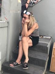 Carnival's joy (giuliazita) Tags: girl sitting london carnival notting hill carnevale candid
