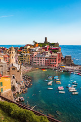 Emerald Waters of Vernazza Sea and Colorful Houses on the Cliff, Cinque Terre, Italy (MedCruiseGuide.com) Tags: vernazza vernazzaport vernazzacinqueterreitaly cinqueterre italia italy italianvacation port colors colorfulhouses coast colorfulboats boats boat sea bluesky sky bluesea cliff hills hiking architecture holiday houses shore summer summervacation seaside beach beachday beachfun vernazzabeach cinqueterrevillage cinqueterrevillages cinqueterrebeaches sun sunnyday swimming sunbathing vacation liguria sailing sand water walk outdoors travel tourism