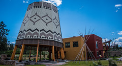 2017 - Road Trip - Osoyoos Indian Band Gathering Space (Ted's photos - For Me & You) Tags: 2017 bc canada cropped nikon nikond750 nikonfx tedmcgrath tedsphotos vignetting osoyoosindianband oliverbc gatheringcentre britishcolumbia building seating seats emptyseats teepee poles gatheringspace cans2s
