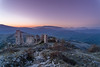 Above The Ruins (Simone Della Fornace) Tags: abruzzo italy ruins hills mountains valleys sunrise purple orange sky nature green nopeople fullframe fulllenght voigtlander sony a7rii landmark landscape hiking calascio rocks building copyspace outdoor