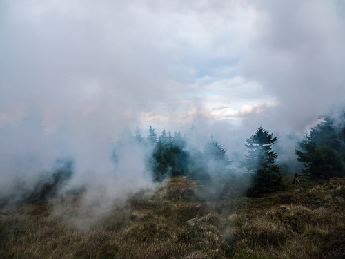 Steam and smoke darken the sky